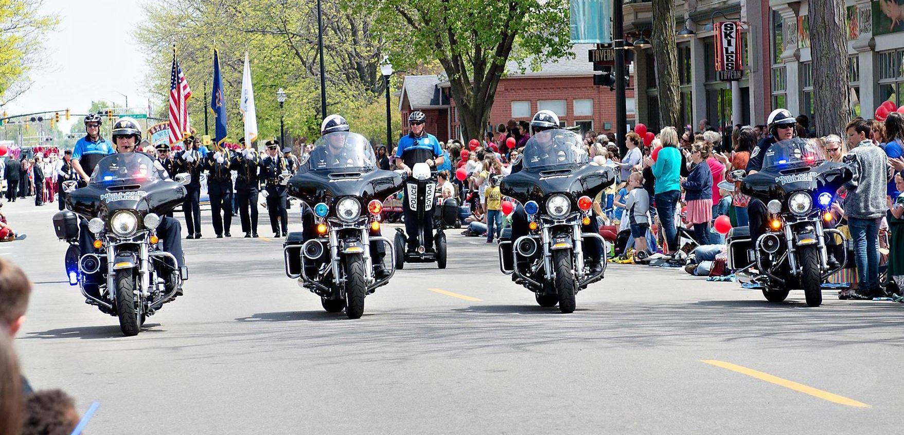 4 officers on motorcycles leading tulip time parade
