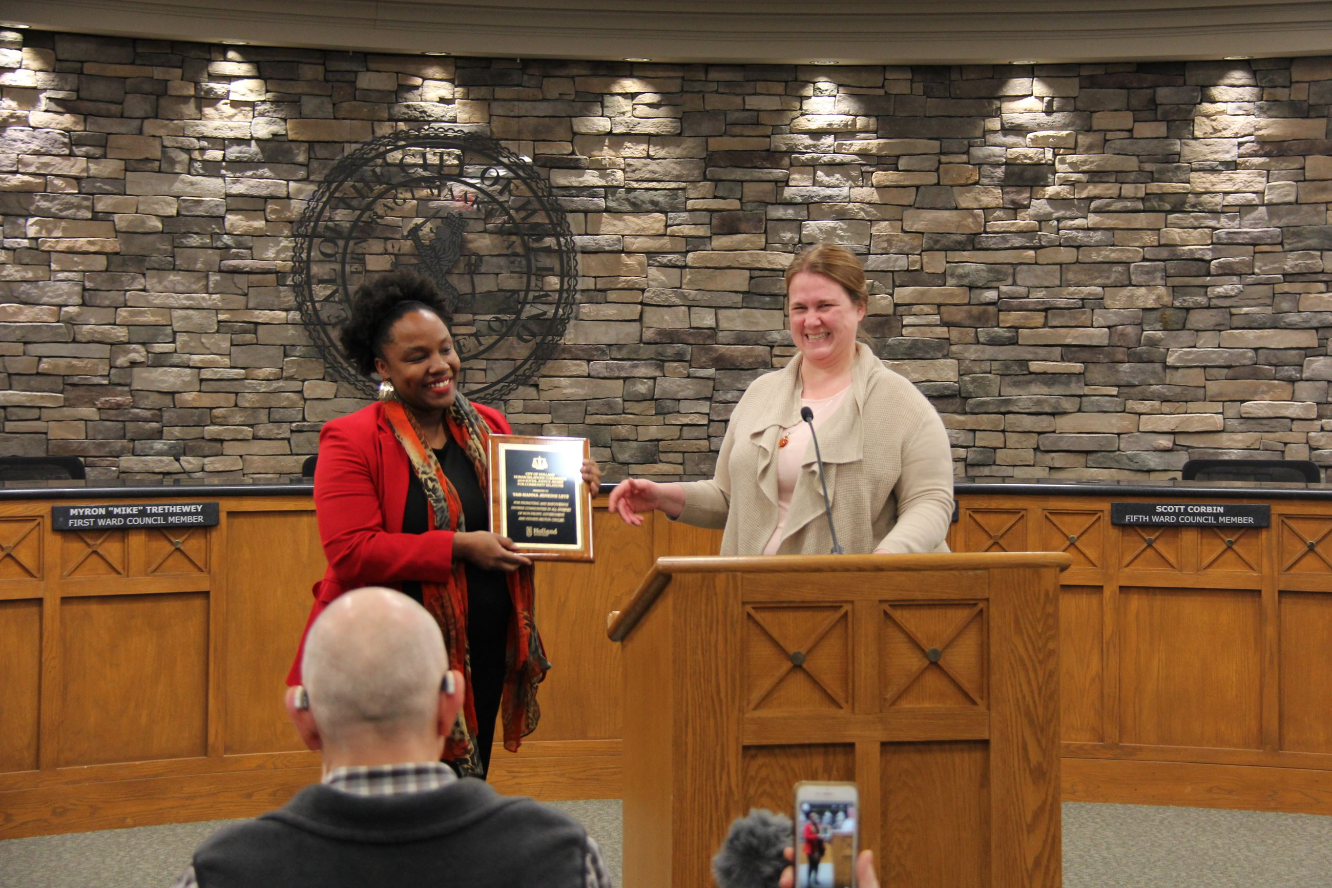 Keiffer Sestric presents Community Relations Award to Yah-Hanna Jenkins Leys