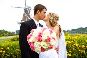 Married Couple Kissing in Front of the Windmill