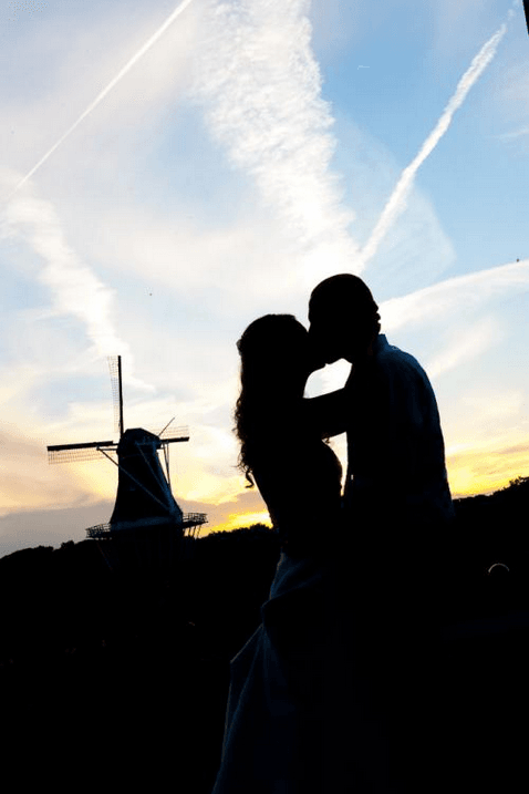 Wedding Couple Kissing at Sunset in Front of the Windmill