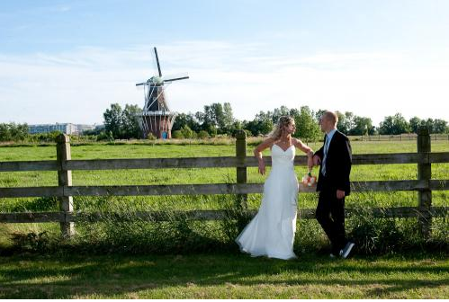 Wedding Couple Posing with the Windmill in the Background