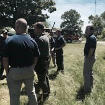 Crisis Negotiation Team Standing in a Field